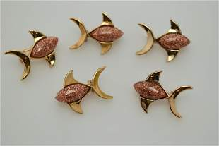 A lot of five matching tiny fish pins.