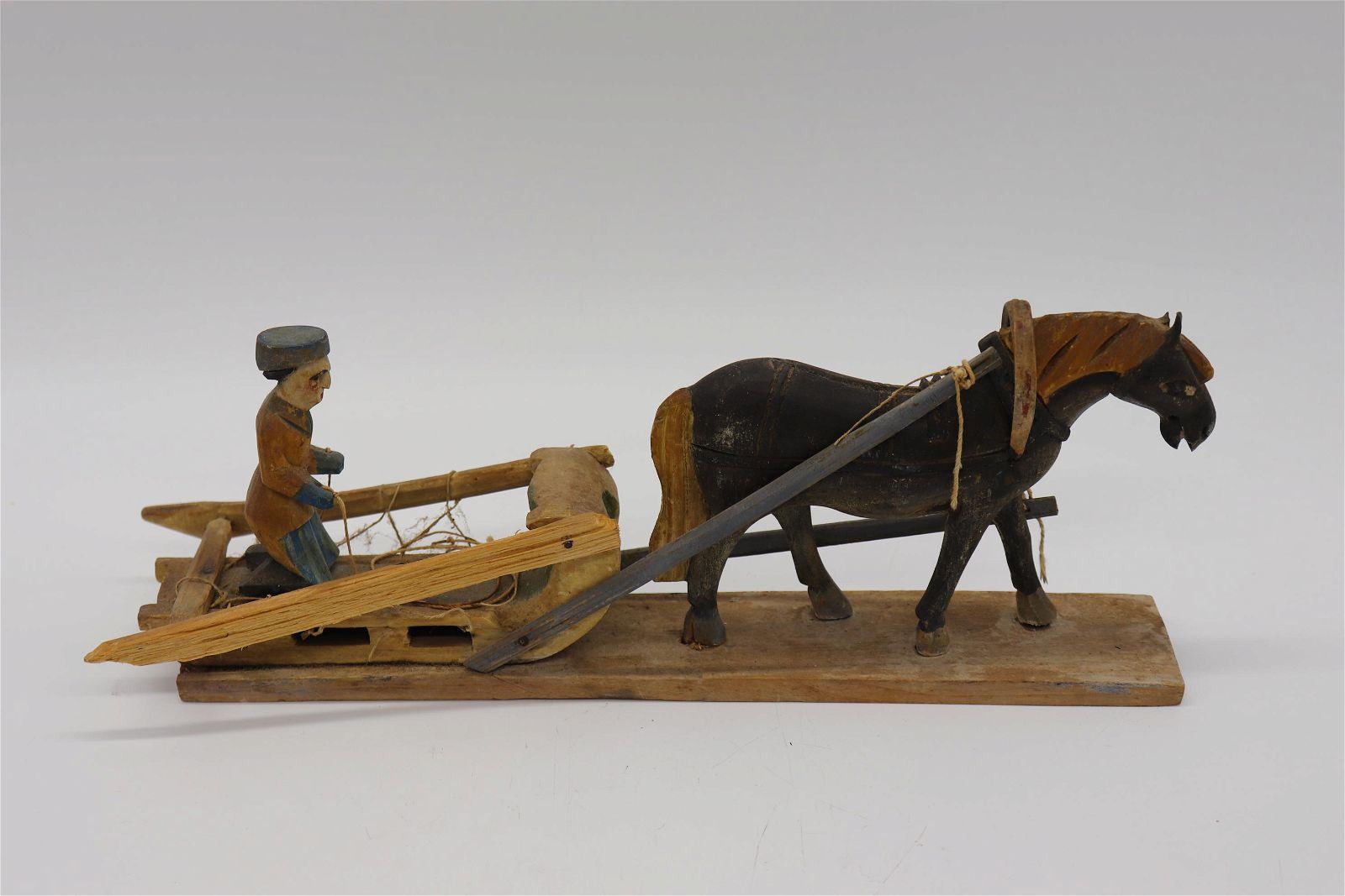 Wooden Folk Art Carving Horse & Man in Sled