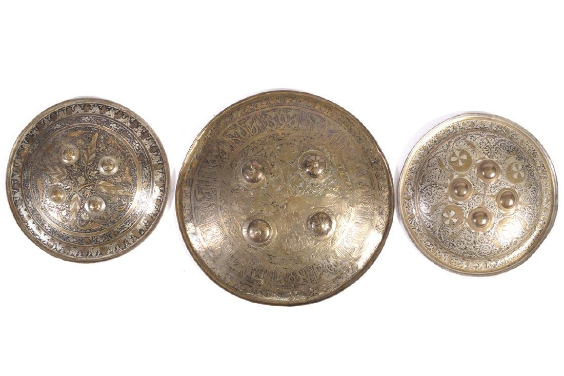 THREE NINETEENTH-CENTURY INDIAN 'DHAL' BRASS MOUNTED