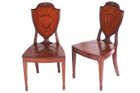 PAIR OF REGENCY PERIOD MAHOGANY ARMORIAL BACKED HALL