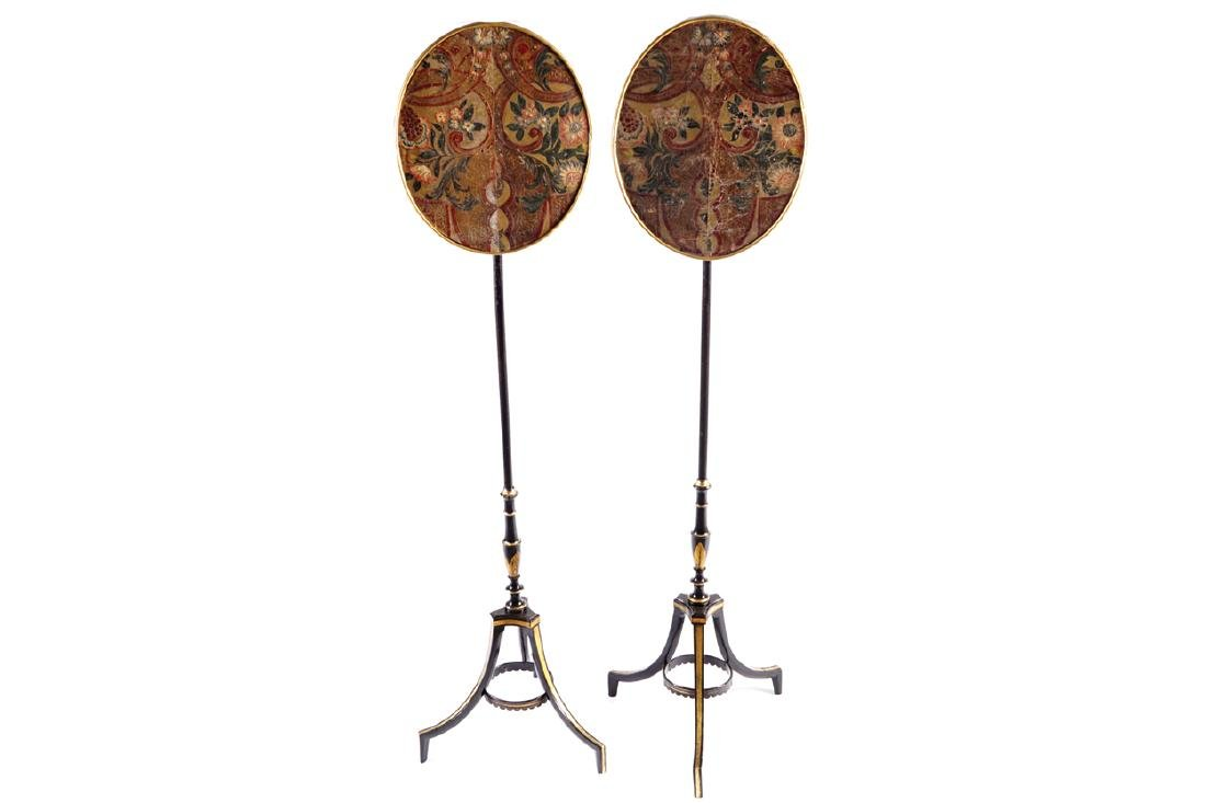 PAIR OF REGENCY PERIOD EBONIZED AND PARCEL GILT POLE