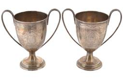PAIR OF IRISH CRESTED SILVER LOVING CUPS