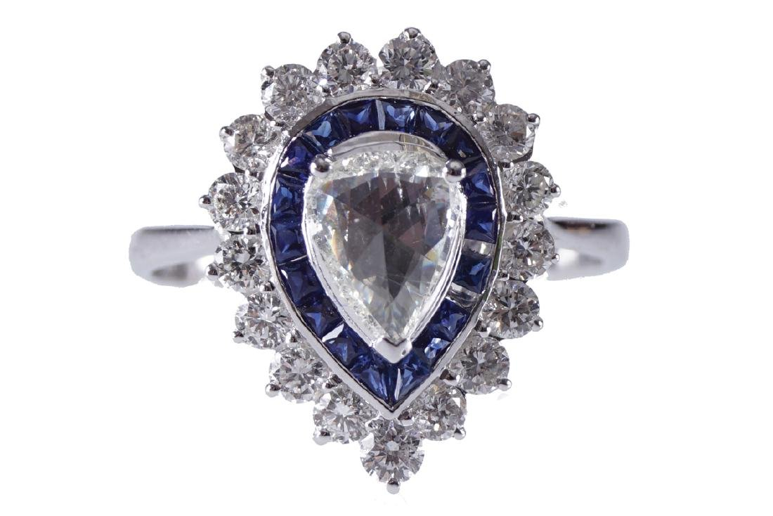 18 CT. WHITE GOLD PEAR SHAPED CEYLON SAPPHIRE AND