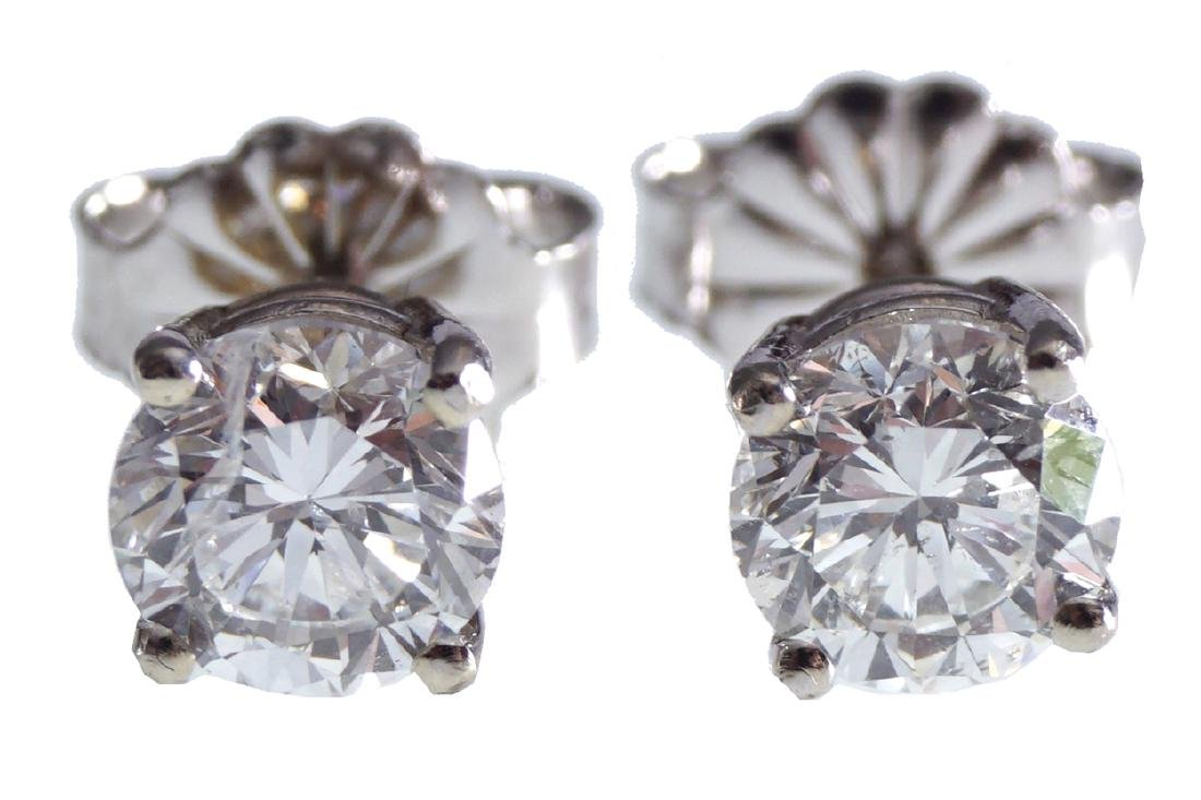18 CT. WHITE GOLD AND DIAMOND STUD EARRINGS