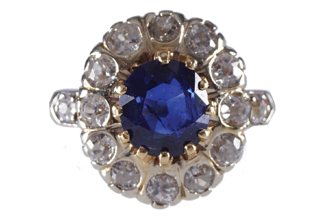18 CT. GOLD SAPPHIRE AND DIAMOND CLUSTER RING