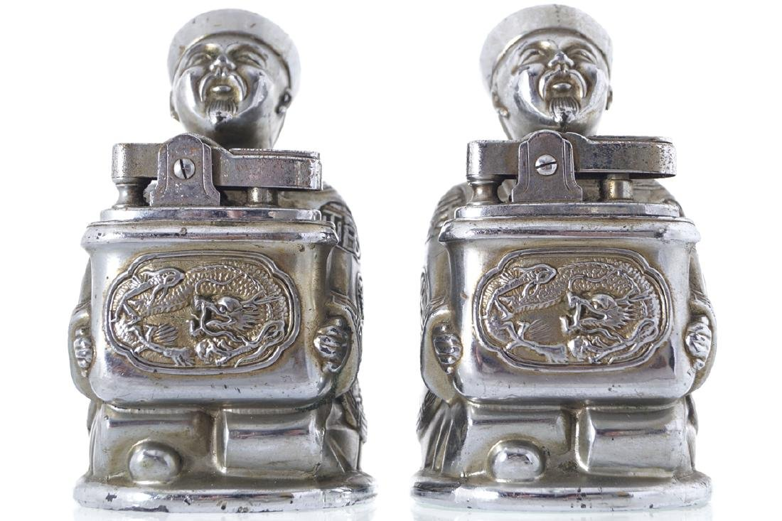 TWO VINTAGE CHINESE FIGURE HELD CIGARETTE LIGHTERS