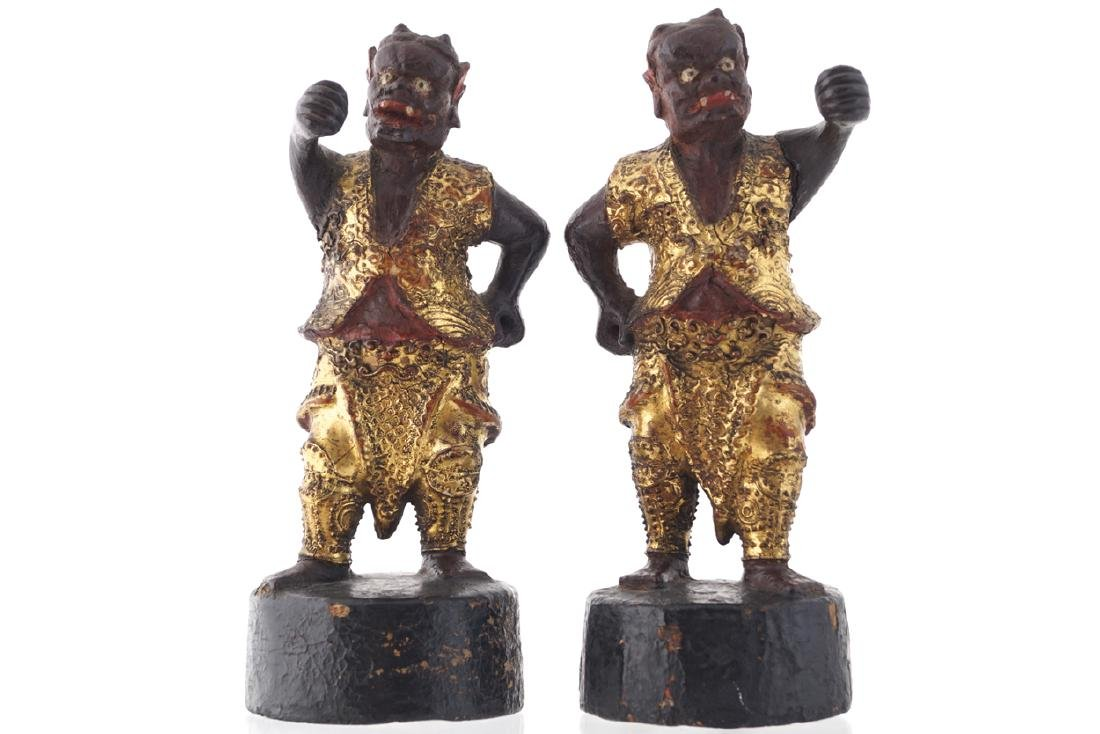 PAIR OF CHINESE QING PERIOD CARVED POLYCHROME AND