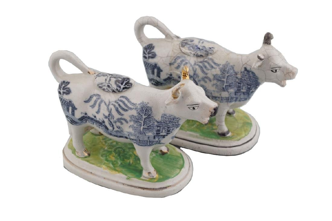 TWO STAFFORDSHIRE BLUE AND WHITE COW CREAMERS