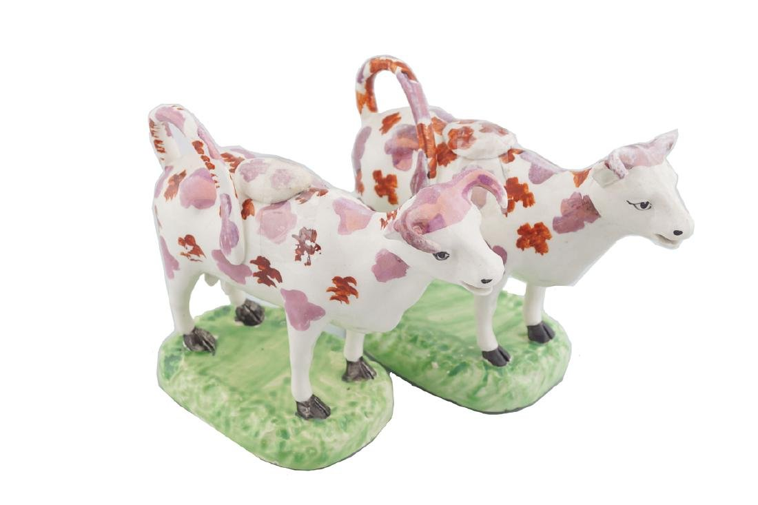TWO STAFFORDSHIRE POLYCHROME COW CREAMERS