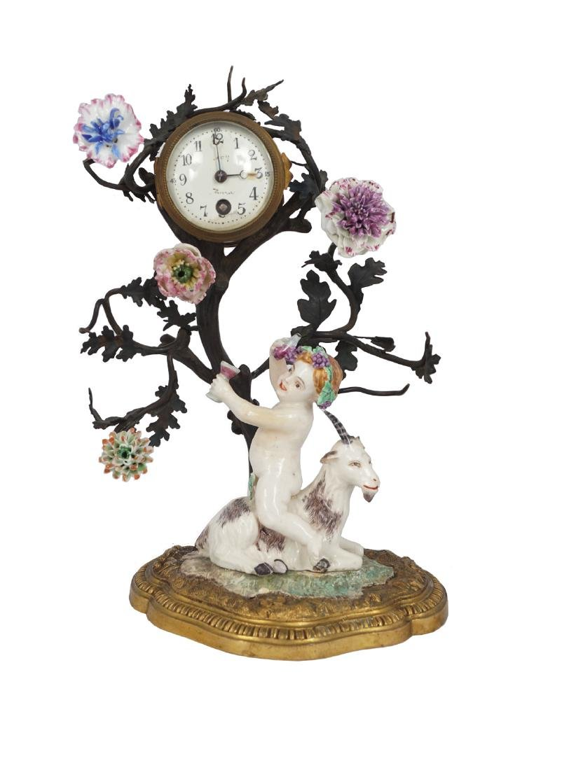 NINETEENTH-CENTURY FRENCH PORCELAIN AND ORMOLU CLOCK