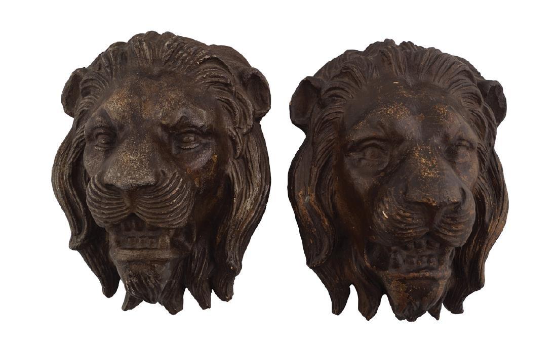 PAIR NINETEENTH-CENTURY TERRACOTTA LION MASKS