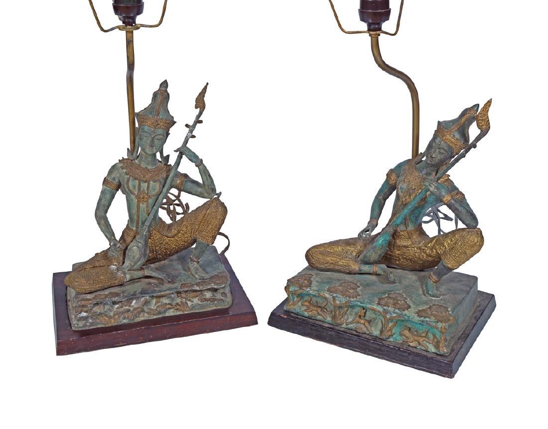 PAIR OF BRONZE THAI DEITY STEMMED TABLE LAMPS