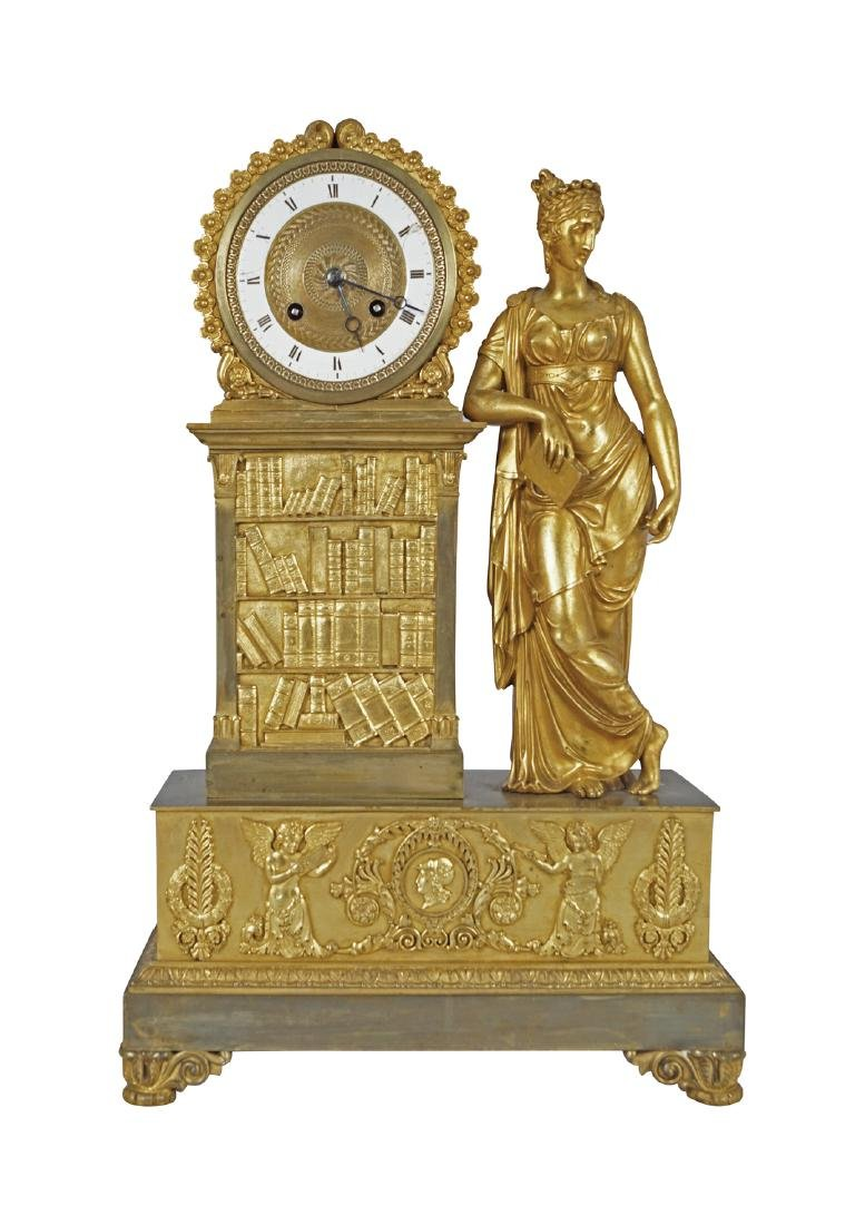 A FINE FRENCH EMPIRE GILT BRONZE MANTEL LIBRARY CLOCK