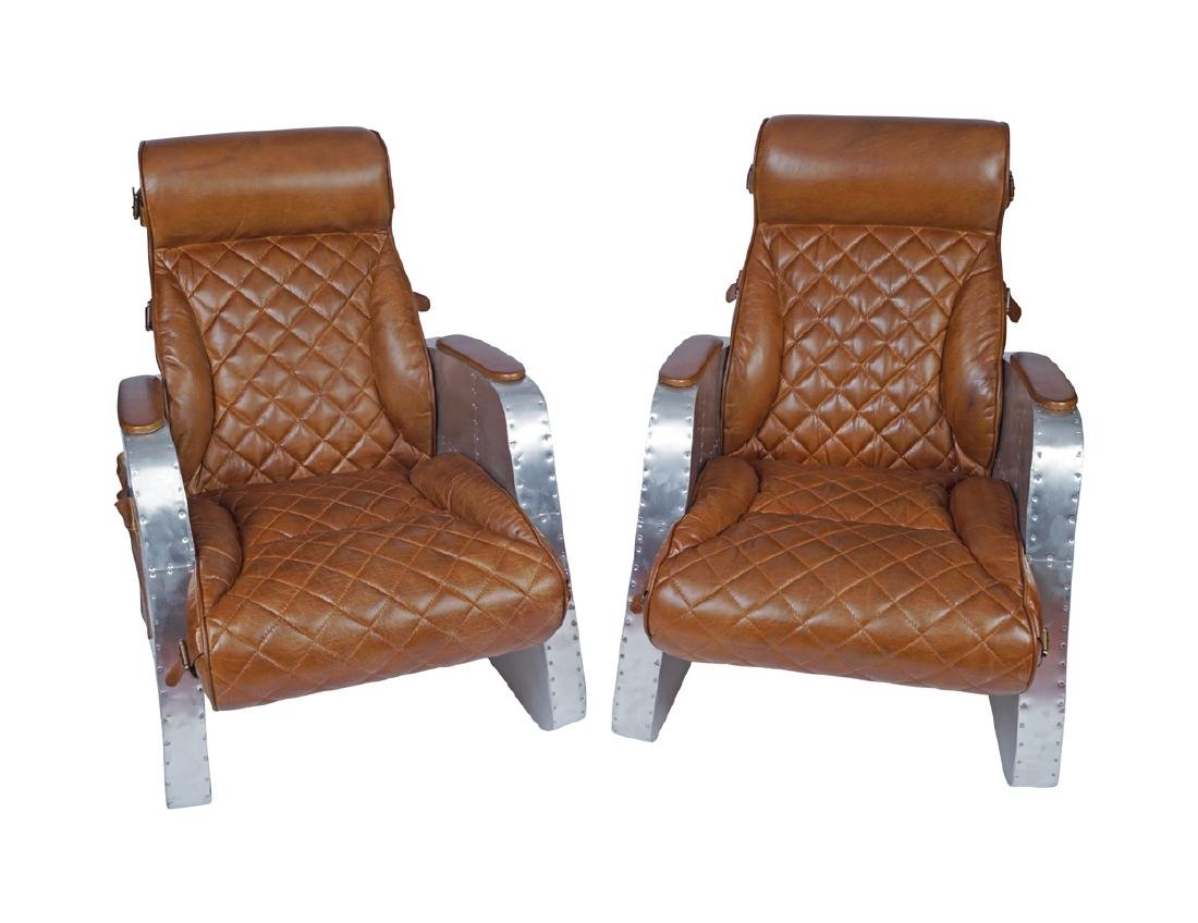 PAIR OF DESIGNER LEATHER AND CHROME ARMCHAIRS