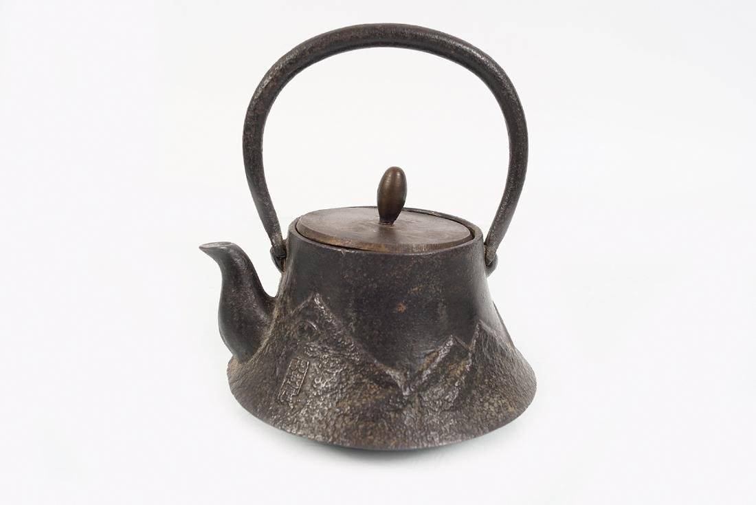 19TH-CENTURY CAST IRON KETTLE