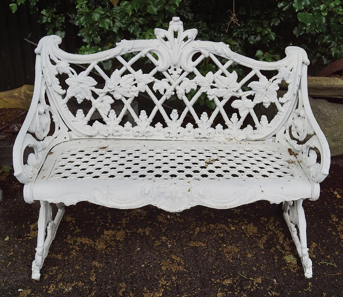 PAIR OF ORNATE CAST IRON GARDEN BENCHES