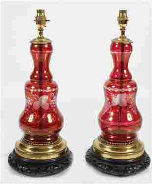 PAIR OF BRASS AND RUBY GLASS STEMMED TABLE LAMPS