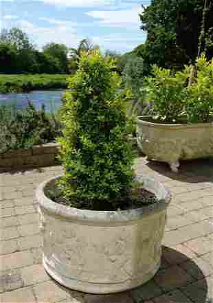 PAIR OF MOULDED STONE CIRCULAR PLANTERS