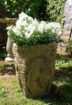 PAIR OF MOULDED STONE JARDINIERES