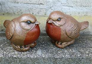 TWO MOULDED STONE BIRDS