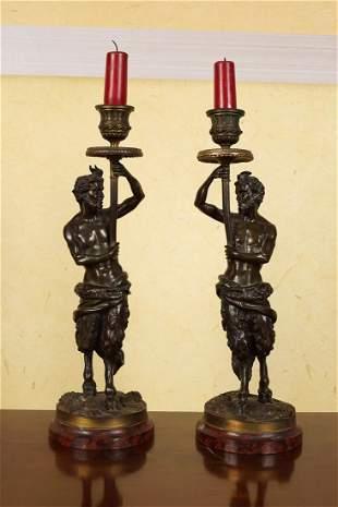 PAIR OF REGENCY BRONZE AND ORMOLU CANDLESTICKS