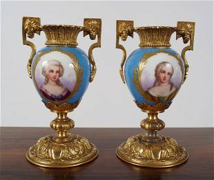 PAIR OF SEVRES AND ORMOLU URNS