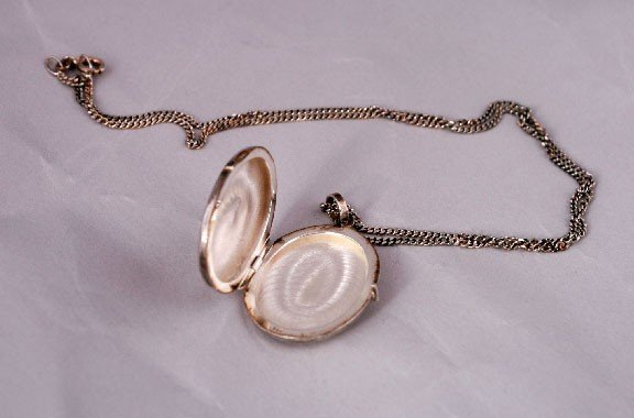 10: Silver locket and chain