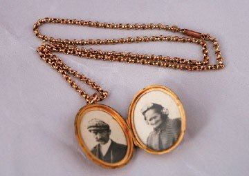 13: Gold locket and chain