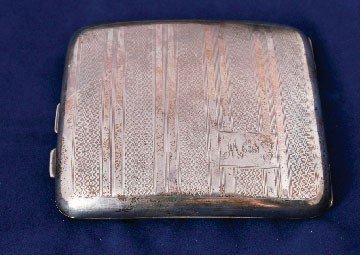 22: Silver cigarette case
