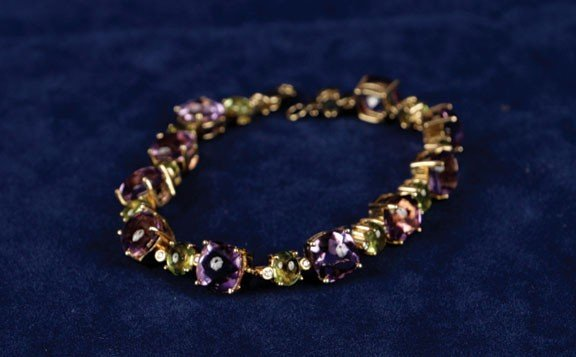 13: Amethyst, peridot and diamond 18ct yellow gold brac