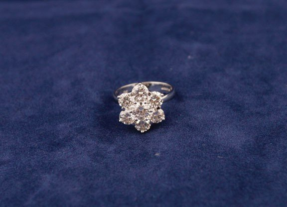 21: 18ct white gold seven stone daisy cluster ring