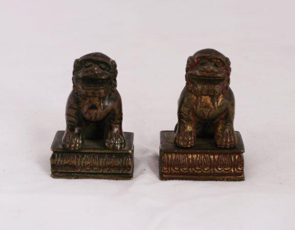 614: Pair of bronze foo scroll weights