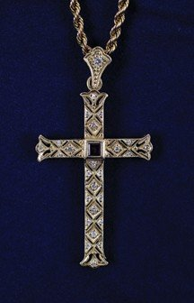 9: Gold diamond and ruby cross and chain