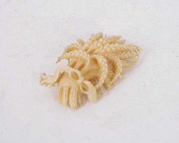11: Nineteenth-century ivory brooch