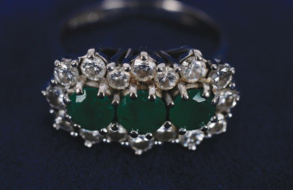 15: 18 carat white gold emerald and diamond cluster rin