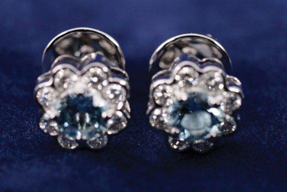21: 18 carat white gold aquamarine (0.58ct) and diamond