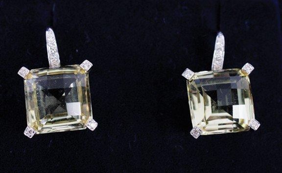 24: 18 carat yellow gold lemon quartz (6.77ct) and diam