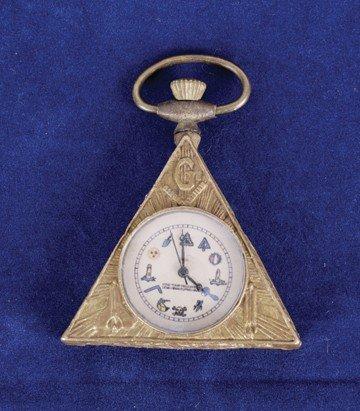 73: Triangular Masonic wind up watch