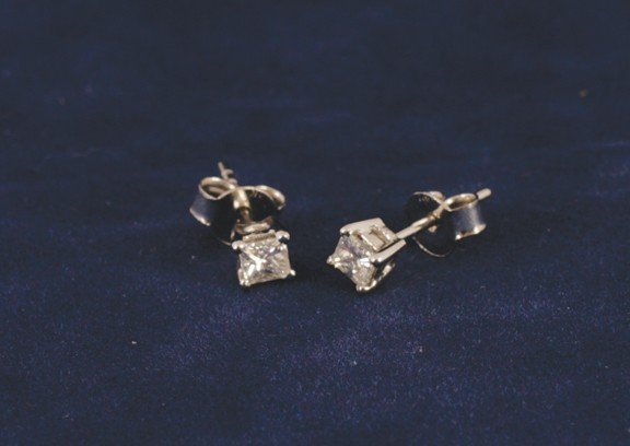 2: 18 ct. white gold four claw set studs