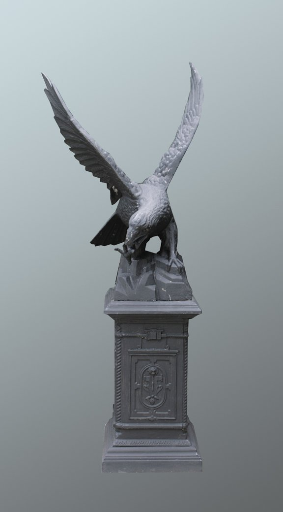 33: Pair of large cast iron eagles
