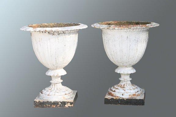 34: Pair of antique cast iron garden urns