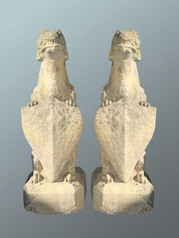 37: Pair of antique composite stone griffins