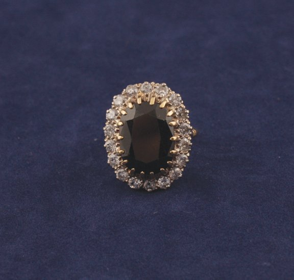 2: 18ct. gold, sapphire and diamond ring