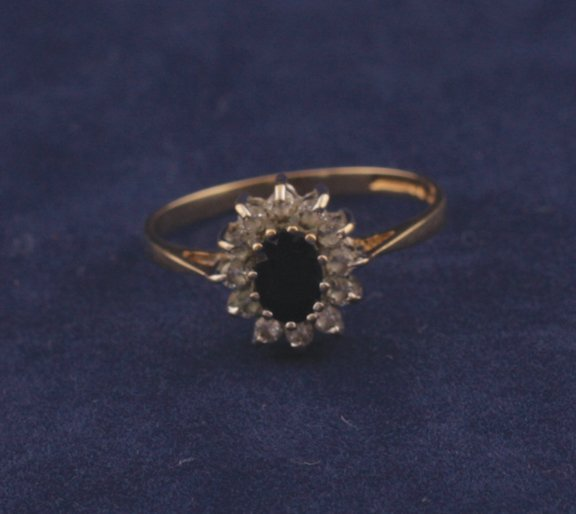 3: 18ct gold, sapphire and diamond ring