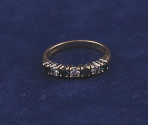 4: 9 ct. gold sapphire and diamond eternity ring