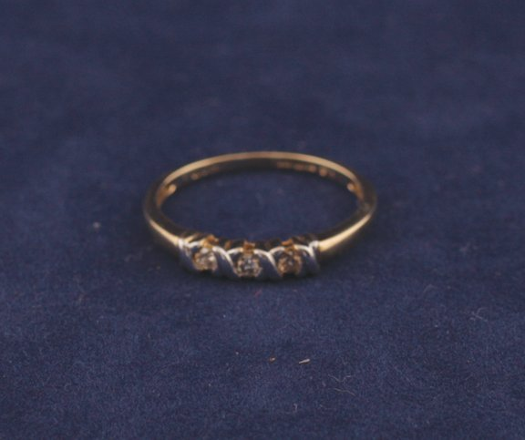 5: 9 ct. gold three stone diamond ring