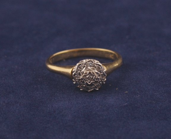 8: 18 ct. gold diamond and marquisette cluster ring