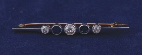 17: Gold diamond and sapphire knife bar brooch
