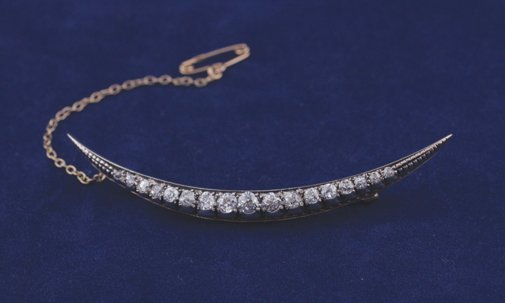 18: Crescent shaped gold and diamond brooch