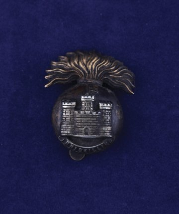 554: The Inniskilling Fusiliers cap badge